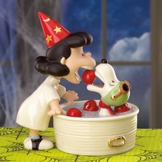 It features Lucy wearing a red pointed wizard's hat with gold stars and moons on it and a white gown with black and white saddle shoes. She is bobbing for apples in a large white tub with gold handles and light blue water inside and three red apples floating on the surface. | eBay!