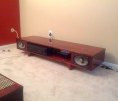 Color me impressed, not only did doitdoitdoit design and make his own coffee table, he built a matching TV stand with integrated audio speakers using some car speakers he had laying around Car Speaker Box, Speaker Stands, Tv Stands, Diy Speakers, Built In Speakers, Best Home Theater System, Home Entertainment, Wood Projects, Entryway Tables