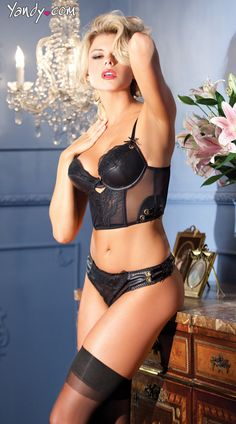 Faux Leather and Lace Longline Bra Set  This sexy set includes a faux leather longline bra with lace cup details, lace panel, keyhole front, lace up detail and matching panty with lace up sides. $43.95