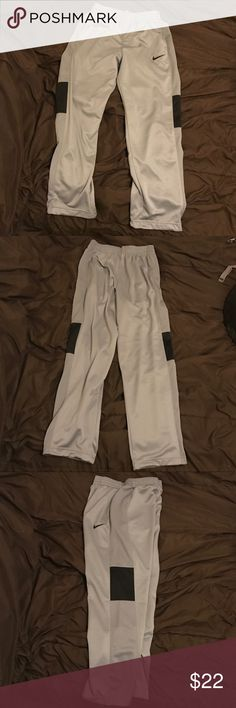 Nike Dri-Fit sweatpants Grey and black Nike Dri-Fit sweatpants. There are a few very small pulls in the fabric on the left knee. Other than that, they're in great condition. Nike Pants Sweatpants & Joggers