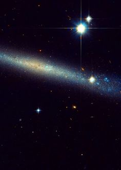 Nasa /ESA Hubble Space Telescope has produced this beautiful images of the Spiral galaxy IC2233, one of the flattest galaxies know.Lying in the Constellation of Lynx,IC2233 is located about 40 million light-years away from Earth