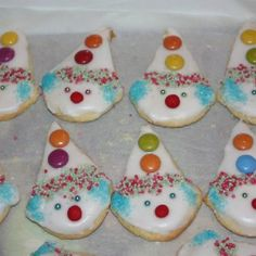 Cookies made with an ice cream cone-shaped cutter, turned upside down and iced to look like clowns.