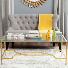 Dramatic in a living room or master suite, the Inga coffee table makes a grand statement with its straight-lined frame and curvaceous stretcher. This elegant piece is crafted of solid iron in a gold l
