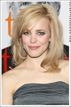 Details:  Hair Style: Rachel Mcadams has her hair styled to the shoulders. This is a great look as the hair has body to it and volume. Rachel's hair has been layered at the back and sides. At front, bangs are styled across at the forehead.  Hair Cut: The hair is cut to a medium length.  Hair Colour: This hair colouring is blonde.  Suitable For:  Face shapes: oval, oblong, heart, round  Hair texture: medium  Hair density: medium  Styling:  Techniques: blow dry  Products: mousse, hair spray