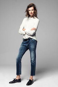 A buttoned up shirt, boyfriend fit denim and stylish black slippers.