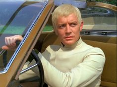 Ed Straker played by Ed Bishop in UFO- Just a man in his car, but a saviour of this 60s world: Straker! Straker! Straker!....