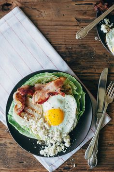 grilled wedge salad with a fried egg and cranberry feta