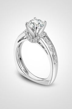 This platinum Simon G diamond ring featuring floral vines is beautiful for a winter marriage proposal.