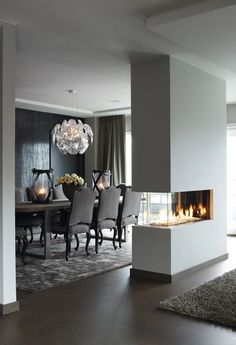 Love the feature fire place. Won't be able to afford one like this but it sure is stunning.