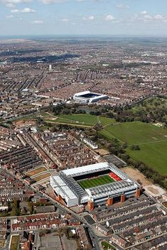 An aerial view of the Stadia of Liverpool FC and Everton FC, Anfield and Goodison Park, seperated by Stanley Park and Anfield cemetery with the Bootle docks in the distance, on April 2008 in Liverpool, England. Liverpool Fc Champions League, Liverpool Stadium, Liverpool Town, Soccer Stadium, Liverpool Football Club, Football Stadiums, Liverpool England, Liverpool History, Football Tops