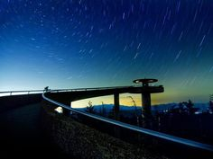 A nighttime view Clingman's Dome in Great Smokey Mountains National Park with the lights of Gatlinburg glowing in the distance