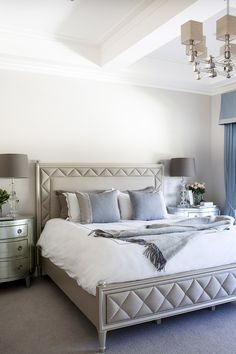 Stunning bedroom: perfect dusty blue, linen upholstery, silver bedsides, window seat and ceilings to die for!