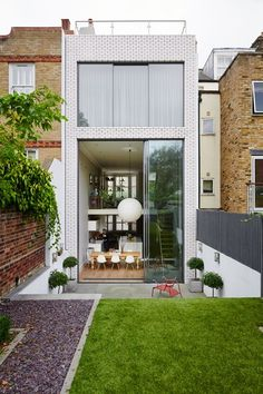 Discover city garden ideas on HOUSE - design, food and travel by House & Garden. These six-metre-high glass doors add fluidity between the kitchen and garden.