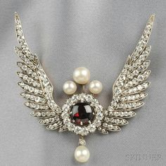 Antique Diamond and Pearl Brooch, designed as a buff-top garnet framed by old European-cut diamonds, and flanked by old mine- and old single-cut diamond wings, approx. total diamond wt. 6.00 cts., pearl accents and drop, silver-topped gold mount, 2 x 2 1/2 in., in a period fitted box. Victorian or Victorian style