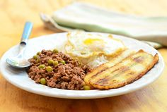 Arroz ala Cubana is a Filipino dish made ground beef cooked in tomato sauce and served with fried eggs, fried bananas and steamed rice
