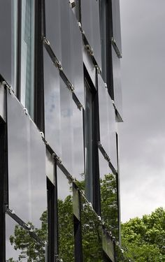 5468796 Architecture Reflective glass panels applied to the exterior of this condominium building in Winnipeg, Canada