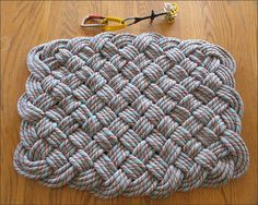 Our climbing rope rug (pic-heavy instructions included) Crochet Rug Patterns, Crochet Yarn, Free Crochet, Crochet Crafts, Rope Rug, Rag Rug Tutorial, Felt Ball Rug, Climbing Rope, Basket Weaving