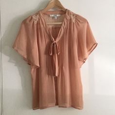 Tie Collar Blouse Peach tie collar blouse with butterfly sleeves. Features pin tucks on the front, and a lace yoke on the shoulder/back. 100% polyester Forever 21 Tops Blouses