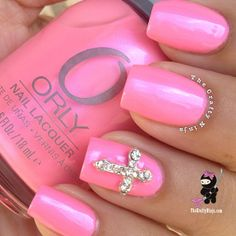 .@Nadia Brendish | Perfect Barbie pink @orlynails Choreographic Chaos  Cross charm from my @win soo hoo...