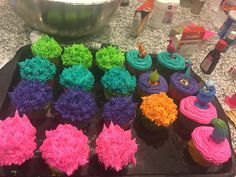I had so much fun making the different color buttercream frosting for these Trolls cupcakes. The piped hair is my favorite.