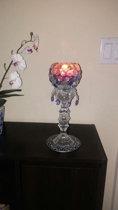 Dollar tree candle holders glued onto votive holder, added stones and placed it on a silver candle base i had...also added hanging gems