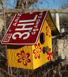 Painted and stenciled birdhouse with license plate roof. Use wood for roof and just overlay with license plate or metal can get too hot in summer and radiant heat off it can harm birds inside. License Plate Crafts, License Plate Art, Bird House Feeder, Bird Feeders, Garden Crafts, Diy Crafts, Craft Projects, Projects To Try, Yard Art