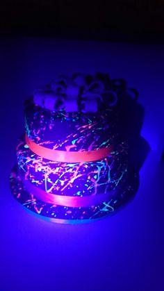 Neon splatter cake glows under black light