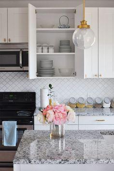 Our Best Renovation Decisions, Part I - white and gold modern kitchen, arabesque tile backsplash, Luna Pearl granite countertops, IKEA cabinets