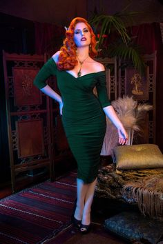 This 50s Laura Byrnes Monica Dress is a wonder of a wiggle! ;-)This beauty reminds us of one of the beautiful dresses which Marilyn Monroe once wore... Beautiful crossover bust line and slightly off-shoulder sleeves, vavoom! Made from an unique matte dark green fabric that will not pill, resists wrinkles and has a beautiful drape and stretch. A built-in stretch bengaline shaper for the bust, waist and lower hip gives support, structure and holds you in, while the gathered oute...