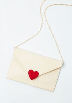 Flirty Fascination Bag. Instantly add a pinch of romance to your ensemble by accessorizing with this heart-touched clutch from Kling! #white #modcloth