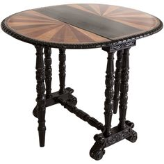 Anglo-Indian folding specimen wood table from Ceylon. Intricate carving on legs and table edge. Base has been newly ebonized.