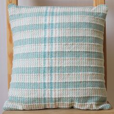 Handwoven green and cream, square cushion. Handwoven on a four shaft loom in my London studio, using a merino wool blend yarn, with stripes of chunky yarn to add structure. Has an envelope fasting and comes with poly fibre pad. Each cushion is unique, and is an individual piece of hand weaving. Treasure it. This cushion measures 17 x 17  Handwoven wool, merino, acrylic front Linen cotton blend back Please hand wash the cover. Cushion cover can be sold separately, just get in touch :)  Made…