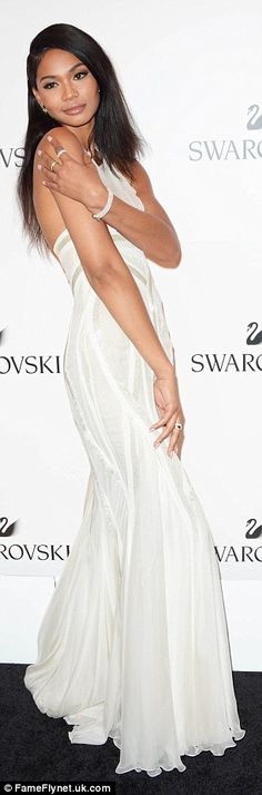 Vision in white: Chanel Iman looked bridal in a white floor-length gown that boasted a bil...