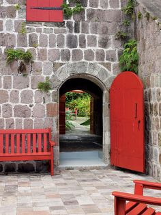 Helen and Brice Marden's Caribbean Hotel - in Nevis.  Instead of typical Caribbean pastels, Helen Marden uses red for architectural accents and furniture.