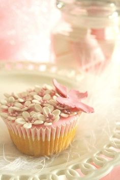 pink butterfly on white icing flowers cupcake