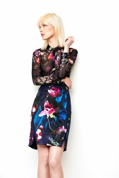 This season, get adventurous with some beautiful, elaborate pattern-clashing! Skirt and sheer blouse by Ted Baker