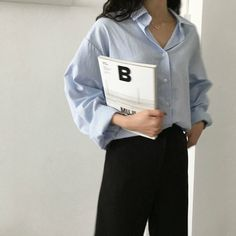 light blue oversized shirt with black (suit) trousers.