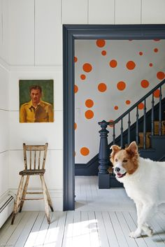 A Scandinavian-inspired living room with industrial furnishings is just off of the polka dot entryway.