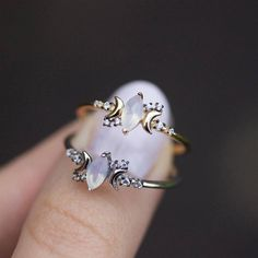 I've just found Opal And Cubic Zirconia Moon Ring In Silver Or Gold. A magical twist on a classic cluster ring. Iridescent central Opal gemstone with moon symbols either side and Cubic Zirconia stars completing the design.. £36.00
