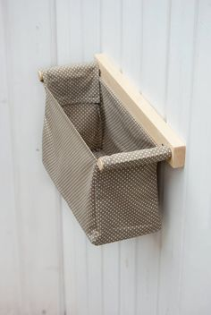 Nursery hanging storage for neutral baby room or baby