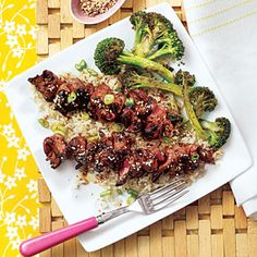 Grilled Teriyaki Steak Skewers with Sesame Broccoli and Brown Rice Garnished with Green Onion