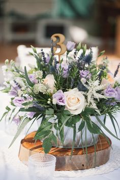 2020 Top 7 Peach Wedding Color Palettes---Peach & Purple wedding centerpieces on wooden slice. Peach Purple Wedding, Lilac Wedding Flowers, Church Wedding Flowers, Spring Wedding Colors, Wedding Flower Arrangements, Flower Bouquet Wedding, Rose Wedding, Floral Wedding, Floral Centrepieces