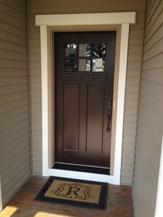 Beautiful brown door, dark hardware and black door step