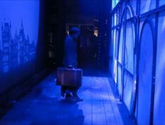 """Awwwe, backstage before she comes through the doors for """"Dear Old Shiz"""" :') And that blue lighting."""
