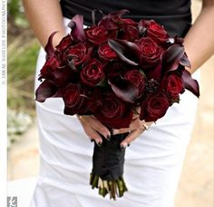 Love the dark calla lilies, just swap the red roses for white tulips, some green orchid, and a few fiddle ferns. :)