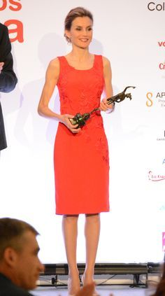 11. She knows when to let her fiery red dress do all the talking, wearing minimal jewelry. via @stylelist
