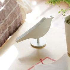 This bird shaped alarm clock wakes you up to the sound of chirping birds or a regular buzzer.  $40
