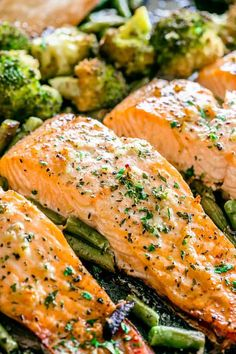 Garlic Butter Baked Salmon - Tender and juicy salmon brushed with an incredible garlic butter sauce and baked on a sheet pan with your favorite veggies. This delicious baked salmon takes just a few minutes of prep and makes for a perfect weeknight meal in Diabetic Salmon Recipe, Delicious Salmon Recipes, Healthy Salmon Recipes, Seafood Recipes, Cooking Recipes, Dinner Recipes, Salmon In Oven Recipes, Garlic Recipes, Simple Salmon Recipe