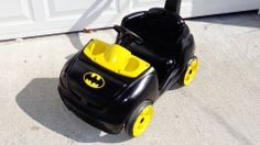 """This was our son's """"Step 2"""" push car, now it is the Batmobile! spray paint and a bumper sticker"""