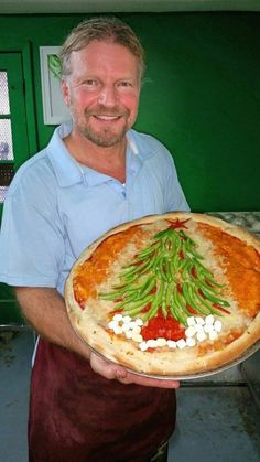 From Pie Zons in Mississippi, Stan Miller with his christmas tree pizza